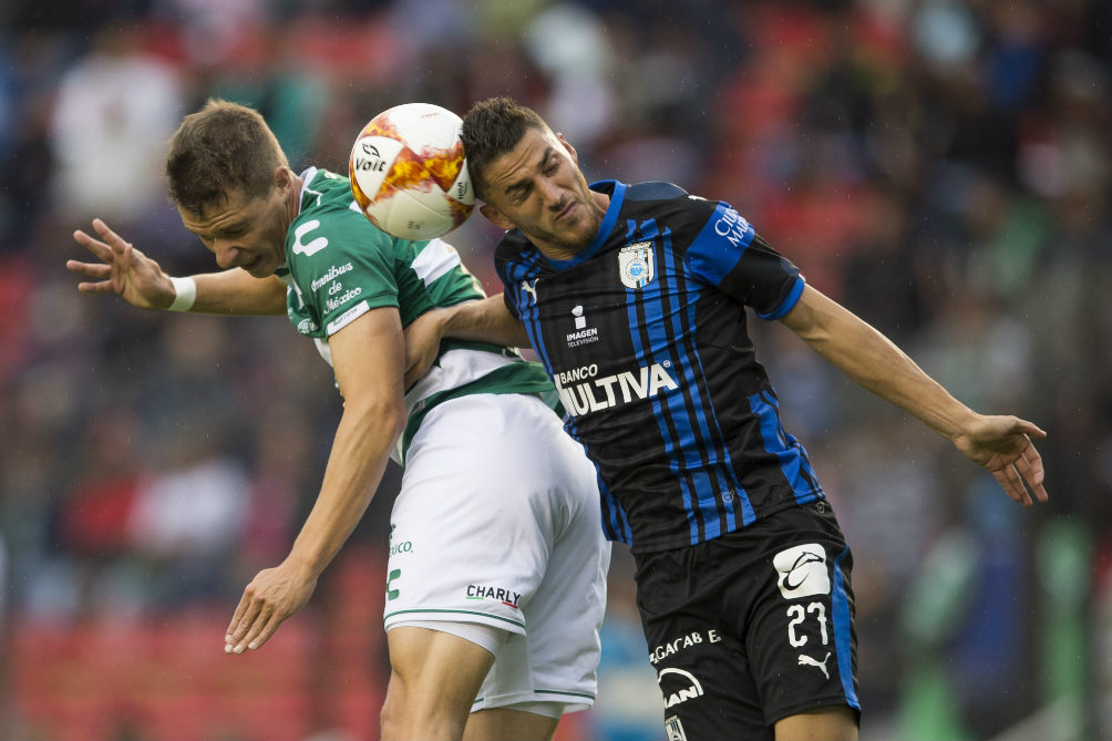 Hiram Mier struggled for the ball against Furch