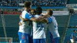 Jugadores de Puebla celebran el gol del empate frente a Cruz Azul