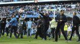 Seguidores del Man City, en la cancha del Etihad Stadium