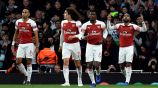 Jugadores del Arsenal festejan gol contra el Valencia