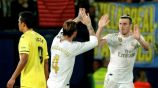 Gareth Bale celebra con Ramos uno de sus goles en el partido