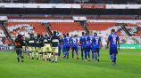 Jugadores de América y Cruz Azul previo a un partido