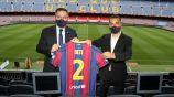 Sergiño Dest y Bartomeu en la presentación del jugador