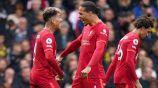 Roberto Firmino y Van Dijk festejando un gol a favor del Liverpool