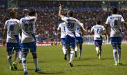 Jugadores del Puebla festejan la goleada contra Atlas