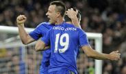 John Terry festeja un gol con Diego Costa
