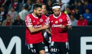 Jugadores de Xolos durante el partido contra Puebla