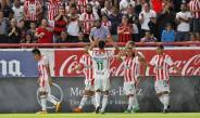 Jugadores del Necaxa festejan gol contra Necaxa