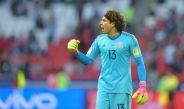 Ochoa festeja el gol de México contra Portugal