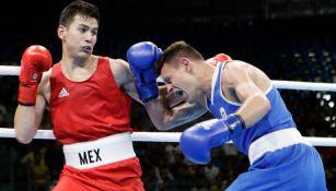Delgado enfrentando a su rival en Juegos Olímpicos