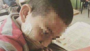 Alumno es castigado por hablar de más con cinta adhesiva