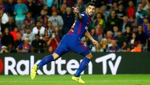 Luis Suárez celebra su gol en el Derbi de Barcelona
