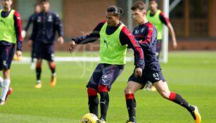 Carlos Peña, en un entrenamiento con los Rangers