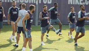 Jugadores del Barcelona durante el entrenamiento