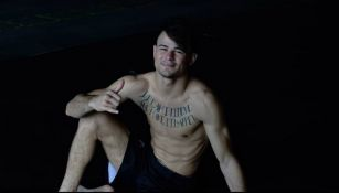 Lopes sonríe luego de un entrenamiento de artes marciales mixtas