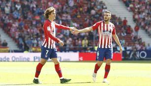 Griezmann celebra con Koke un gol del Atlético