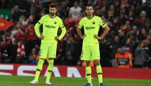 Piqué y Busquets tras la eliminación del Barcelona