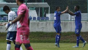Angulo y Orelien en festejo de gol