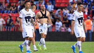 Jugadores de Pumas tras un partido de visita
