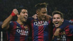 Luis Suárez, Neymar y Lionel Messi durante un juego con el Barcelona