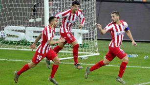 Koke festejando su anotación ante Barcelona