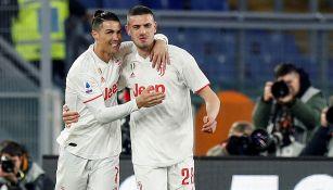 Cristiano Ronaldo celebra un gol con Merih Demiral