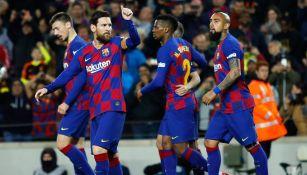 Messi festeja un gol con el Barcelona