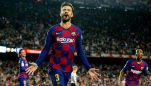 Piqué celebra una anotación con el Barcelona