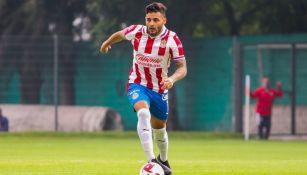 Alexis Vega en partido con Chivas