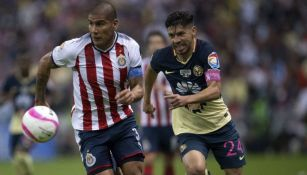 Carlos Salcido y Oribe Peralta