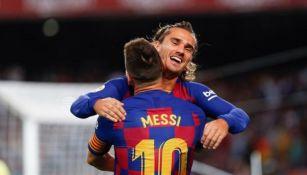 Lionel Messi y Antoine Griezmann en un partido del Barcelona