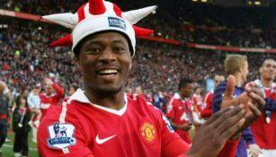 Patrice Evra, en festejo con el Manchester United