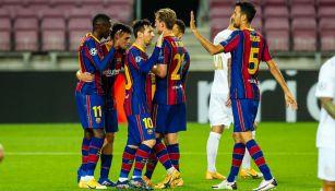 Jugadores del Barcelona festejan un gol