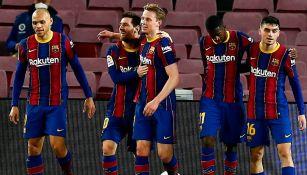 Jugadores del Barça festejan una anotación