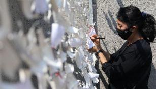 Muro improvisado a la victimas del Covid-19 en la Basílica