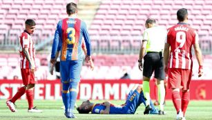 Sergio Busquets antes de salir del partido contra el Atlético de Madrid