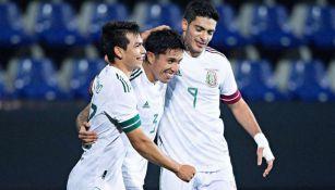 Selección de México en festejo de una anotación