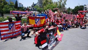Hinchas del Atlético de Madrid en la Fuente de Cibeles