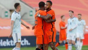 Jugadores de Holanda celebrando un gol a favor