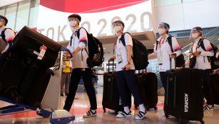 Atletas asiáticos arribando a Tokio