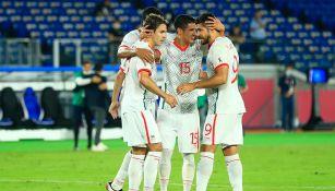 Jugadores de México festejan un gol contra Corea