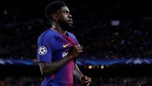 Samuel Umtiti reacciona durante partido con el Barcelona