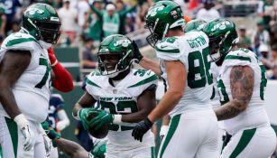 Jugadores de los Jets festejando un touchdown