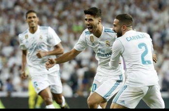 Marco Asensio celebra gol con sus compañeros