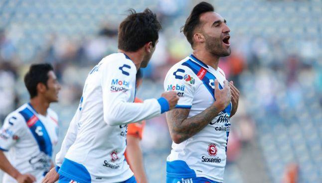 Miguez celebra el primer gol de la Franja