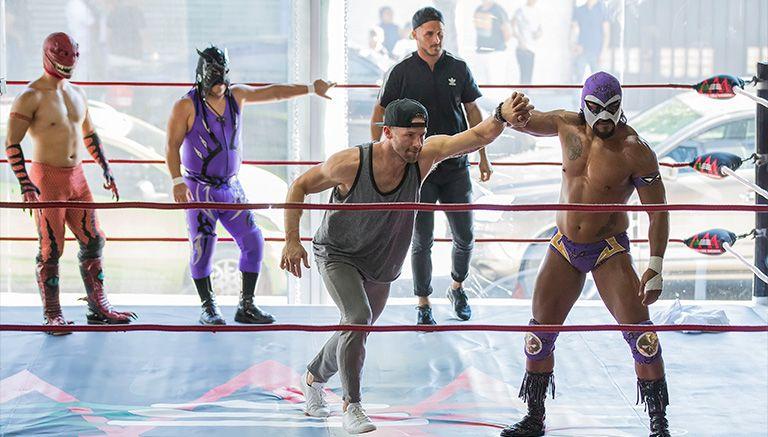Edelman y Amendola en el ring con luchadores de Triple A