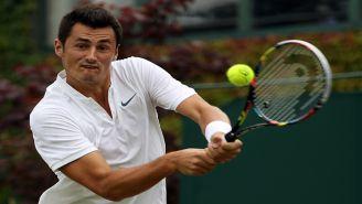 Tomic, durante un partido en Wimbledon