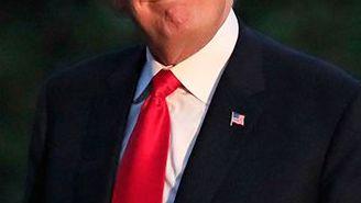Trump sonríe a los medios en su llegada a la Casa Blanca