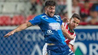Lucas Cavallini en un partido de Puebla