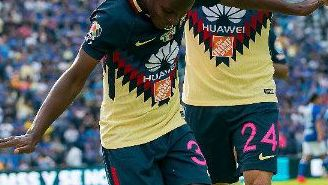 Quintero festeja junto a Peralta su gol contra Cruz Azul